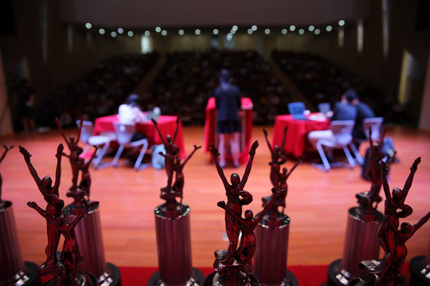 Prize statuettes at a debate championship