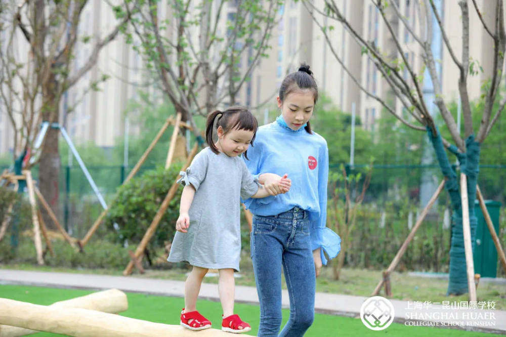 A teacher and student play outside together